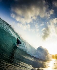 Barrels of fun: Teenage surfing sensation Hiroto Arai lets it rip along the coast of the Amami Islands in his native Japan. Image: Kenyu Takahashi http://win.gs/1ezGfUS #surf #arai #barrel