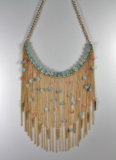 BIB Goldtone Chain NECKLACE Embellished with Tiny Blue Operculum and Barbados Peppermint sea SHELLS. $85.00, via Etsy.