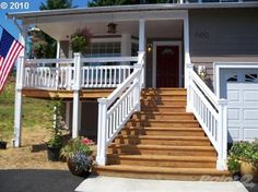 Cedar front deck with white railing... beautiful & love that it's cedar!