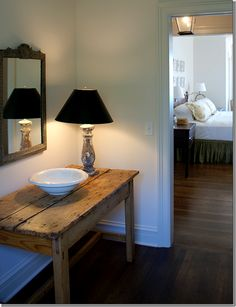 love the rustic table with silver lamp and black shade
