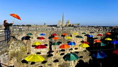 Louise Wyatt stands in a new art installation called 'Umbrella Sky' inside Clifford's Tower, York in England, on October 9, 2012. The installation is a light hearted look on the recent bad weather suffered by the city. It is the first time the medieval tower has had any kind of covering since an explosion blew off the roof in 1684. (Photo by Anna Gowthorpe/PA Wire)
