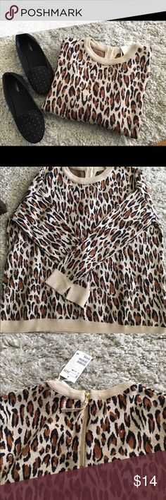 NWT H&M Cheetah Sweater This is a reposh. It is a little to baggy for me, says medium but can easily fit a large. Has zipper in back. Hate to get rid of it. H&M Sweaters Crew & Scoop Necks