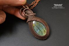 Wire Wrap Pendant. Natural Stone Labradorite Wire Wrap Pendant - 75 X 33 mm Oval cabochon of Labradorite - 38 x 24 mm. A large labradorite with beautiful bright colors. Vibrant Flash, visible inclusions characteristic of stone. Сopper wire - 1mm; 0,4 mm The copper part of the pendant is patinated and polished to give it a vintage look. Chain Antique Copper 4 mm - 580 mm