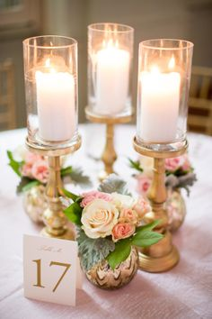 29 Candle Wedding Centerpieces That Will Instantly Set A Romantic Mood - Pillar candles with gold stands - Elegant wedding ideas Winter Wedding Centerpieces, Flower Centerpieces, Wedding Decorations, Centerpiece Ideas, Candlestick Centerpiece, Graduation Centerpiece, Simple Centerpieces, Table Decorations, Picture Centerpieces