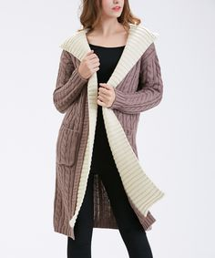 Simply Couture Beige Cable-Knit Hooded Cardigan | zulily  . $32.99 Compare at $99.00  .  size: size chart. S M L XL     Product Description:  Layer on the style with this supersoft cardigan that features a classic cable knit and cozy hooded design.      100% acrylic     Hand wash     Imported
