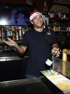 Scott Eastwood works behind the bar at Geoff Stults' birthday party fundraiser to benefit The Charlotte and Gwenyth Gray Foundation at Rock and Reilly's Irish Pub on December 9, 2015 in West Hollywood, California.