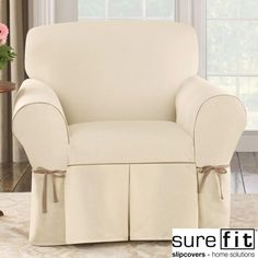 Protect your chair from stains with this sleek chair slipcover from Sure Fit. This cover features crisp natural color and a contrast cord duck pattern. Made from a cotton/polyester blend, this practical cover is also machine washable.