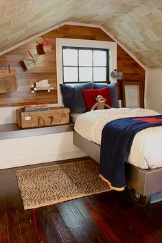 What a cool attic bedroom! From the bed on wheels to the clothespin art hangings, it's a stylish solution for a small space. ceiling is old book pages
