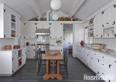 """(No awkward corner cabinets! Long straight countertops for setting up buffet areas. Table in the middle offers plenty of seats for guests to keep the cook, """"chef"""", company!)"""