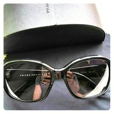 Prada sunglasses Great classic Pradas, in really good condition. Got them last year, have worn a few times, took really good care of them. Only have 2 tiny scratches on the left lense (last picture ) nothing to compromise the look or quality. Come with original box and cleaning cloth as in picture. Prada Accessories Glasses