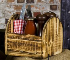 Serve your condiments in a handmade wooden condiment holder, providing a simple, rustic look to your tabletops.