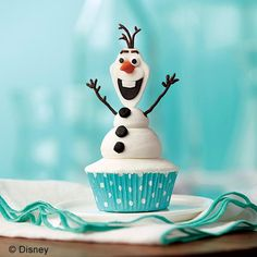Olaf the Snowman Cupcakes - Do you want to build a snowman? Now you can, anytime — using buttercream icing and fondant for an Olaf the Snowman from Frozen Cupcake! It's easy to build a snowman anytime — just make extra snowman heads, arms and buttons so all you need to do is prepare a batch of cupcakes and icing and decorate.