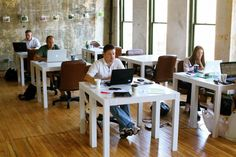 Diligent coworkers hard at work at The Raleigh Forum, a downtown coworking space