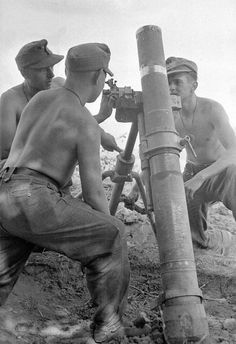 A German mortar crew operates a 12 cm Granatwerfer 42 during operations in Italy. The 12 cm GrW 42 was developed in 1942 as a heavier, close support mortar. The similar Russian PM 38 in 120 mm was captured in significant quantities on the Eastern Front and was immediately pressed into service.Because of the greater weight of the GrW 42 (280 kilograms or 620 pounds) a two wheeled axle was utilized, enabling the mortar to be towed into action.