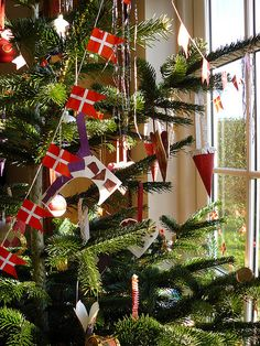 Garlands of Danish flags are a traditional decorations on Danish Christmas trees. Danes traditionally light the Christmas tree with real candles. This takes great care, of course...and a fire extinguisher nearby!