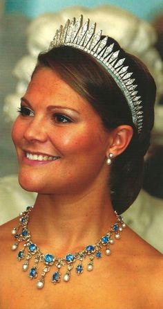 Victoria, Crown Princess of Sweden is wearing the Baden Fringe Tiara and a diamond and sapphire necklace. This necklace is part of what is known as the Processional Jewels. The necklace is made of Ceylon sapphires, baroque pearls and diamonds.