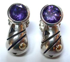 John Atencio Amethyst Earrings - Amethyst earrings signed and designed by John Atencio. Made is sterling and 18kt yellow gold. A250-106. (subject to prior sale) -- Lilliane's Jewelry -- 4101 W. 83rd St. Prairie Village, KS 66208 -- 913-383-3376 –