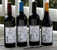 10 Creative Wedding Guest Book Ideas: Signing bottles of wine...also work as table numbers!