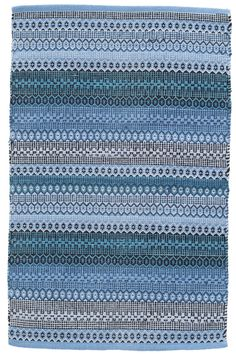 This woven cotton area rug-featuring a graphic pattern of interlocking checks-is the final puzzle piece to any modern space. Embrace the blues with this boho woven cotton area rug. In shades of denim, navy, teal, and Swedish blue, this rug can...