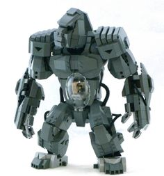 Zane Houston—author of the greatest Lego mecha I've ever seen—has a new cool mecha out: a gorilla. Piloted by a chimp. Anything with apes automatically has my vote, but this is brilliant on its own right, with a solid construction and perfect styling. Lego Mecha, Bionicle Lego, Lego Robot, Legos, Chateau Lego, Technique Lego, Construction Lego, Niklas, Amazing Lego Creations