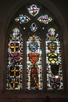Heraldic medieval stained glass from the late 14th or early 15th century in Chicheley Chapel on the Wimpole Hall estate in Cambridgeshire.
