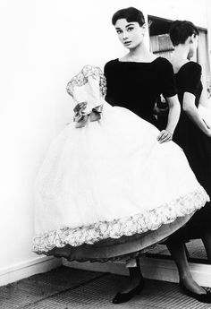 vintagegal:  Audrey Hepburn holding the Givenchy white point d'esprit ball gown from the film Love in the Afternoon (1957)