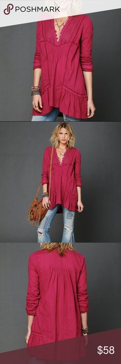 Free People Pintuck Texture Tunic This raspberry colored long sleeve tunic by Free People is covered in pretty eyelet detailing. Size is XS but this could definitely also fit a size S since the style is pretty loose. Small rip a little less than 1 cm long toward the bottom of the center panel, but it is really not visible when the tunic is on because of how the material lays. In great condition otherwise! Free People Tops Tunics