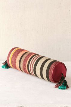 Even TASSLES on a round pile. // Magical Thinking Fezo Woven Bolster Pillow // urban outfitters