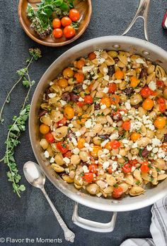 Greek Pasta Skillet with Burst Cherry Tomatoes is a high protein gluten-free pasta meal that's on the table in 25 minutes!