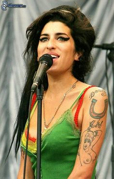"""Amy Winehouse- is an eclectic artist, post-third wave. Check out: """"Just Friends"""", """"You're Wondering Now"""" (The Specials), """"Hey Little Rich Girl"""" (The Specials), """"Monkey Man"""" (Toots & The Maytals), """"Cupid"""" (Johnny Nash/Sam Cooke)....there are many other reggae version she may cover personally or in voiceover"""
