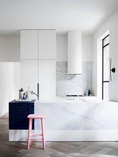 White marble kitchen with herringbone floors. | Photo: Mark Roper | Story: BELLE