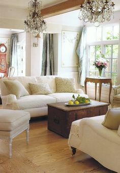 Love the chest for a coffee table and see the swedish clock in the background?  Love!
