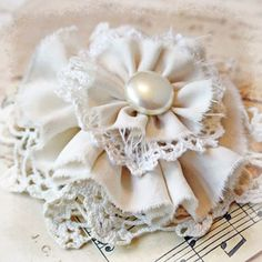 Pin or brooch or corsage handmade in the shape of a flower using vintage silk fabric and crocheted doilies. The flower center is an old clip on earring. Creamy white color. Great gift topper to adorn Moms package for Mothers Day. Measures approx 4 1/2 across.    more tattered flowers:  http://etsy.me/I2yKYh    more handmade:  http://www.cottonridgeemporium.etsy.com    my vintage shop:  http://www.cottonridgevintage.etsy.com