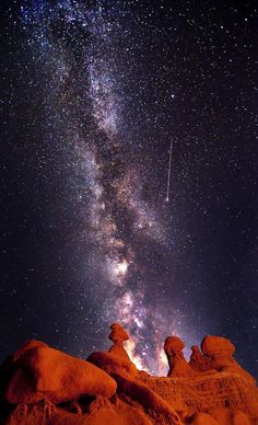 Shooting Star and Milky Way over Goblin   Valley National Park in Green River, Utah. Photo Credit: Bret Webster    The   Milky Way is seen in the distance over a collection of hoodoos, tall spiny   columns of rock which protrude from the bottom of arid basins.