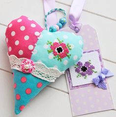 Fabric heart from Helen Philipps. I like the cross stitch flower.
