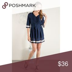 Navy Lace Trimmed Dress Very cute Navy Dress. The dress measures approximately 18in. from shoulder to hem. 3/4 length sleeves with waist tie. 97% Polyester, 3% Spandex. Dresses Mini