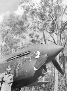 """George Preddy in front of his P-40 Warhawk """"Tarheel.""""  Preddy was an Ace with the P-51 mustang, recording 23 of his 26.83 air-to-air kills in the P-51.  Preddy, a NC native, was KIA on December 25, 1944."""