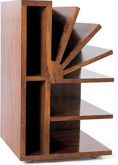 Brazilian architect Gregori Warchavchik designed this masterpiece for his home in Sao Paolo in 1928. The magazine rack 'Leque' is made out of polished Imbuia wood and has been re-edited.