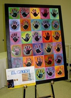 good group project: black acrylic hand prints, watered down tempera on colored paper. by nicky.jackson.908
