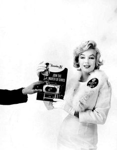 Marilyn in a publicity photo for the March of Dimes. (1958) (The March of Dimes was established by FDR to fight polio)