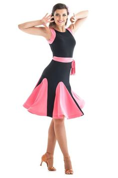 This cute and fun latin ballroom dance dress belongs in your dance wardrobe. Sleeveless bodice features jewel neckline at the front and scoop at the back, wrapped waist belt and soft crinoline hemline