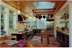 Hang pots and pans from above for clutter-free cabinets.