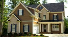 Black And Gray Exterior House In Lakeside Exterior House Paint Color Chart Exterior Paints With Accents