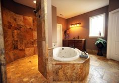 Like the way the shower curves behind tub but wouldn't want walk through and would want glass block half wall behind tub