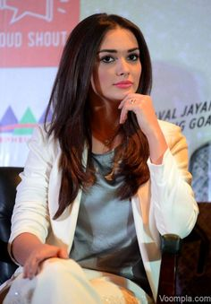Amy Jackson looks beautiful in pink lips and a white suit by Encrustd. via Voompla.com