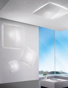 """Axo Light  Nelly Straight.  55"""" sq x 8.6""""H or 39.3"""" sq x 5.9""""H or 23.6""""sq. x 5.9""""H."""