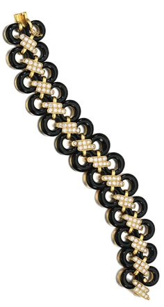 ONYX AND DIAMOND BRACELET, VAN CLEEF & ARPELS, 1970S designed as a series of annular onyx links joined by baton motifs of brilliant-cut diamonds, length approximately 190mm, signed VCA NY and numbered, maker's mark