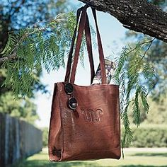 """Love this """"Running W"""" King Ranch tote.  I received it as a gift from Santa. It is beautiful in person and goes with everything. This carry-all tote is crafted of brown, veg-tanned leather tumbled in 50-year-old wooden barrels to create its incredible softness. Inside zipper pocket, leather key loop, accented with the Running W brand and antique brass magnetic snap closure. Made in USA."""