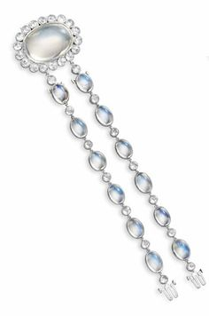 A SET OF MOONSTONE AND DIAMOND JEWELRY Comprising a necklace, designed as a flexible line of bezel-set oval cabochon moonstones, spaced by collet-set rose-cut diamonds, suspending twin girandole moonstone and diamond pendants; a pair of ear pendants and a bracelet with a detachable clasp en suite, mounted in 18k white gold, necklace 17 ins., bracelet 6 ins., bracelet may also be attached to the necklace