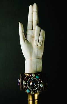 """Hand of Justice (1804)      Artist: Martin-Guillaume Biennais  Material: Ivory, copper, gold and cameos, including the so-called """"Ring of Saint Denis"""" from the Treasure of Saint-Denis.  Musée du Louvre, Paris"""
